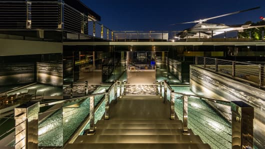 ... A Massage Room And Spa, Fitness Center, Two Wine Champagne Cellars, The  Most Advanced Home Theater In Any U.S. Home, And An 85 Foot Infinity Pool.