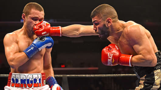 Sergey Lipinets, (blue gloves) from Moscow, Russia, during his IBF Junior Welterweight Bout against Lenny Zappavigna, (red gloves) from New South Wales, Australia, at the Galen Center at the University of Southern California on December 10, 2016 in Los Ang