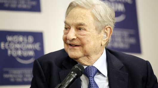 George Soros, billionaire and founder of Soros Fund Management LLC, looks on during an interview at the World Economic Forum (WEF) in Davos, Switzerland, on Thursday, Jan. 21, 2016.