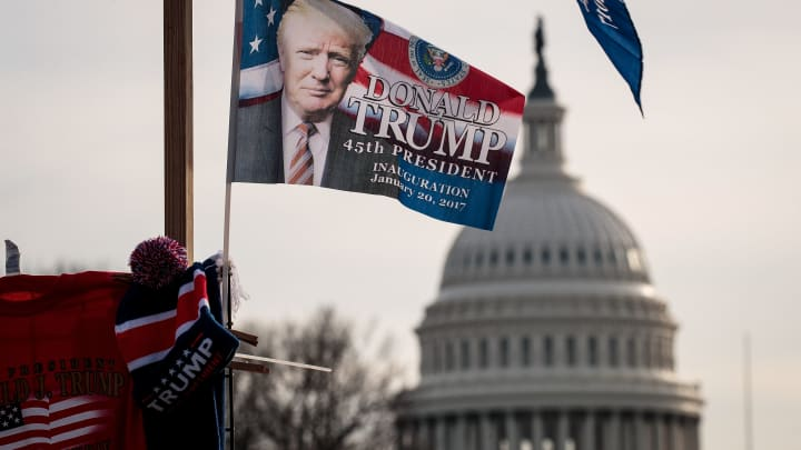 With the U.S. Capitol in the background, 'Trump' flags fly on top of a merchandise stand on North Capitol Street