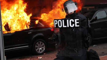 Police and demonstrators clash in downtown Washington after a limo was set on fire following the inauguration of President Donald Trump on January 20, 2017 in Washington, DC.