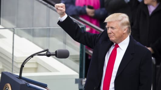 President Donald Trump raises his fist to the crowds during the 58th U.S. Presidential Inauguration after he was sworn in as the 45th President of the United States of America in Washington, USA on January 20, 2017.