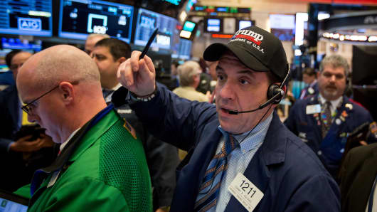 A trader wears a hat displaying the name of U.S. President Donald Trump while working on the floor of the New York Stock Exchange (NYSE) in New York.