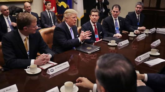 President Donald Trump delivers opening remarks during a meeting with (L-R) Wendell Weeks of Corning, Alex Gorsky of Johnson & Johnson, Michael Dell of Dell Technologies, Mario Longhi of US Steel, and other business leaders and administration staff in the Roosevelt Room at the White House, Jan. 23, 2017 in Washington, DC.