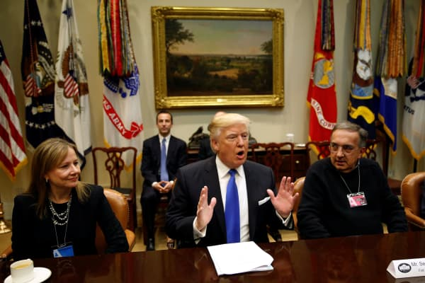 Flanked by General Motors CEO Mary Barra (L) and Fiat Chrysler CEO Sergio Marchionne (R), U.S. President Donald Trump hosts a meeting with U.S. auto industry CEOs at the White House in Washington January 24, 2017.