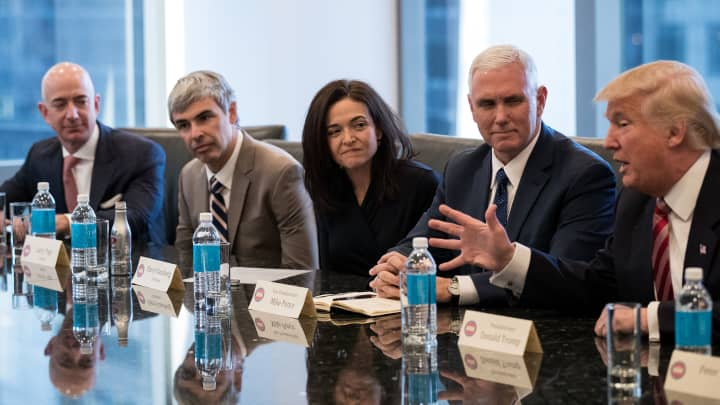 (L to R) Jeff Bezos, chief executive officer of Amazon, Larry Page, chief executive officer of Alphabet Inc. (parent company of Google), Sheryl Sandberg, chief operating officer of Facebook, Vice President-elect Mike Pence listen as President-elect Donald Trump speaks during a meeting of technology executives at Trump Tower, December 14, 2016 in New York City.