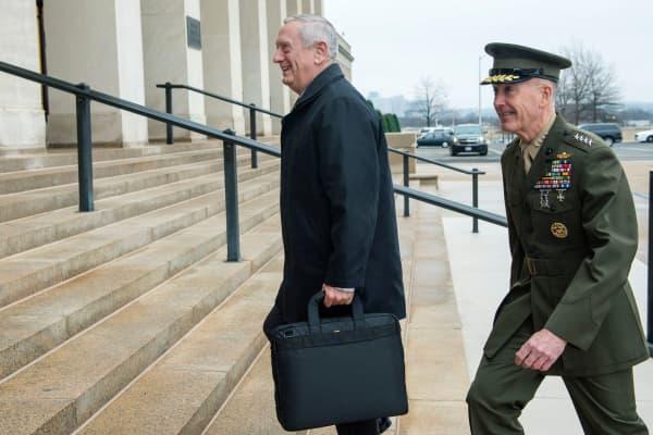 Secretary of Defense James Mattis (l) arrives at the Pentagon on January 21, 2017.