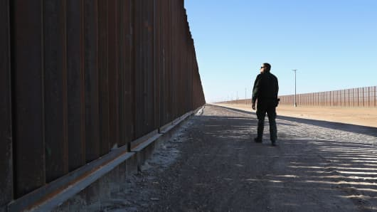 A U.S. Border Patrol agent stands at the U.S. - Mexico border fence on November 17, 2016 in San Luis, Arizona.