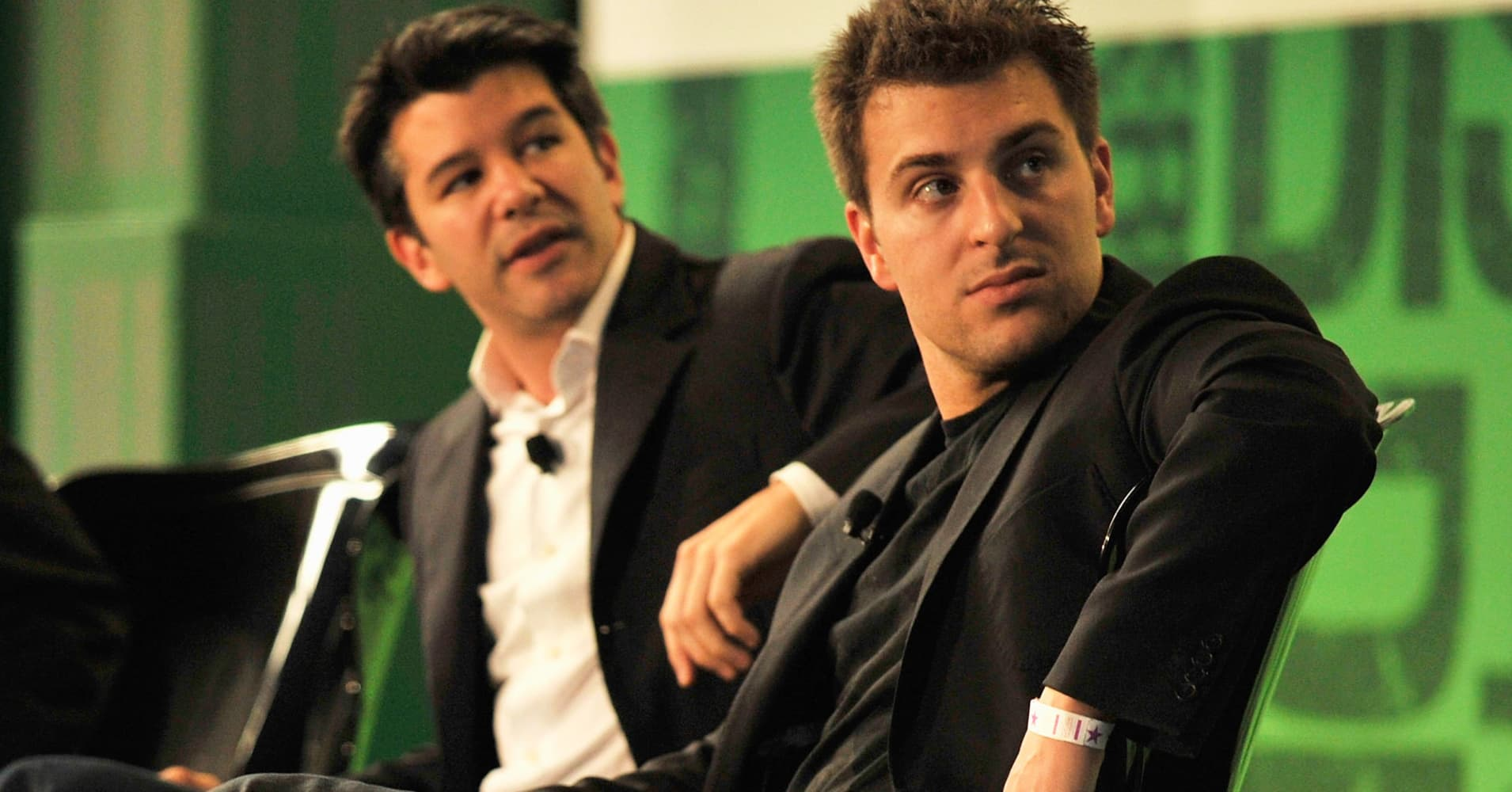 Travis Kalanick, CEO of Uber, left, and Brian Chesky CEO of Airbnb.