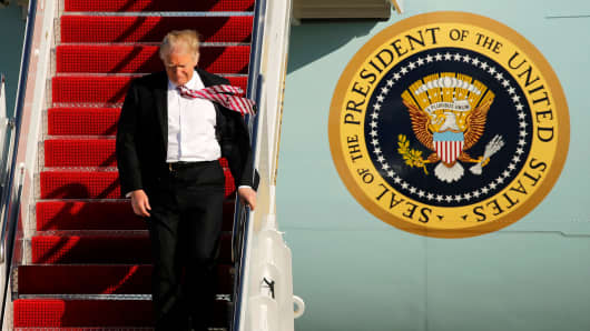 President Donald Trump arrives aboard Air Force One at Joint Base Andrews, Maryland, January 26, 2017.
