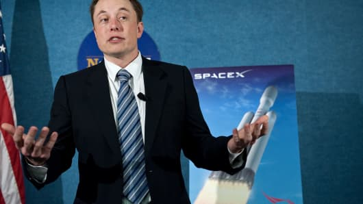 SpaceX CEO Elon Musk unveils the Falcon Heavy rocket at the National Press Club in Washington,DC