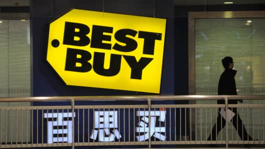 A person walks past a Best Buy logo on February 22, 2011 in Shanghai, China. The U.S. consumer electronics retailer closed all of its stores in China in 2011.