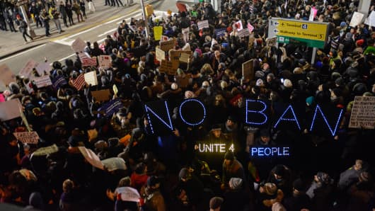 Protesters rally during a demonstration against the travel ban at John F. Kennedy International Airport on January 28, 2017 in New York City.