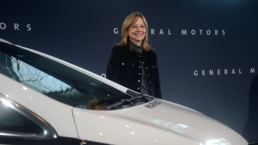 Mary Barra, Chairman and CEO of General Motors, poses with an autonomous vehicle during a General Motors press conference at the Renaissance Center on December 15, 2016 in Detroit, Michigan.