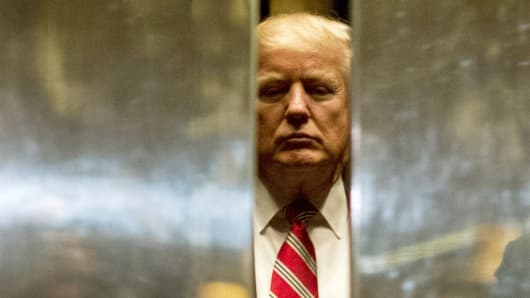 Donald Trump boards the elevator to the lobby after meetings at Trump Tower in New York City.