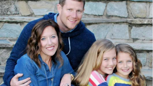Todd and Michelle Buelow with their daughters Riley (left) and Ella.