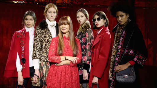 Kate Spade Chief Creative Officer Deborah Lloyd (C) poses with models wearing the label's Fall 2017 collection at the Russian Tea Room on February 10, 2017, in New York City.