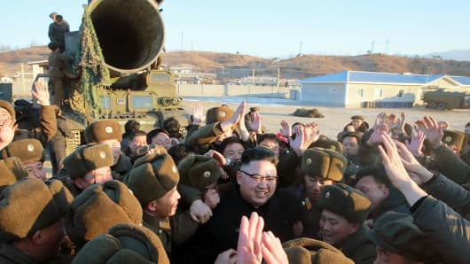 This photo taken on February 12, 2017 and released on February 13 by North Korea's official Korean Central News Agency (KCNA) shows North Korean leader Kim Jong-Un (C) surrounded by soldiers of the Korean People's Army as he inspects the test-launch of a surface-to-surface medium long-range ballistic missile Pukguksong-2 at an undisclosed location.