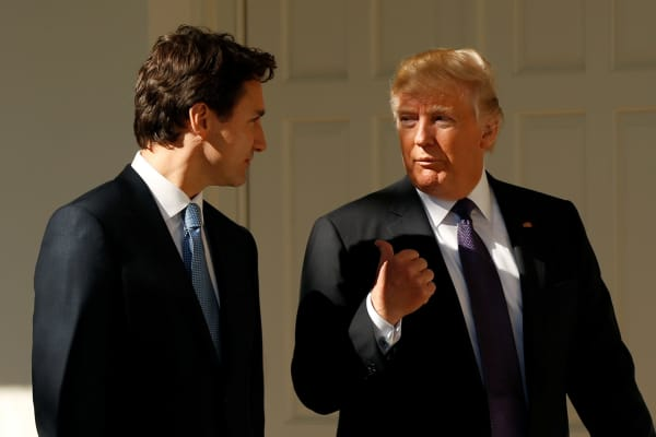 President Donald Trump and Canadian Prime Minister Justin Trudeau walk from the Oval Office to the Residence of the White House in Washington, February 13, 2017.