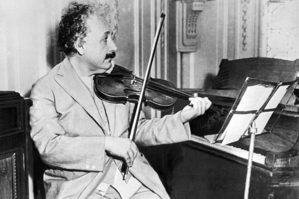 Albert Einstein playing the violin at Princeton University in 1931.