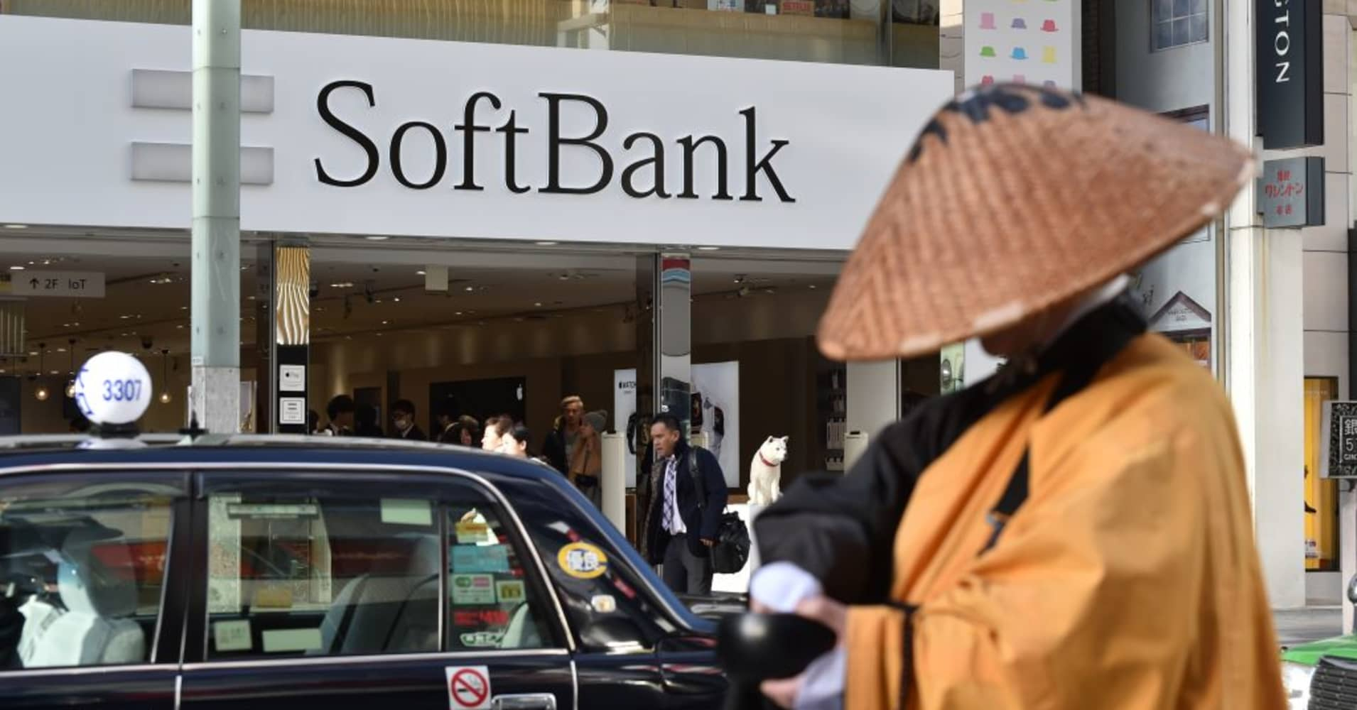 softbank to buy fortress investment for billion
