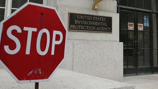 A stop sign stands outside the Environmental Protection Agency (EPA) building in Washington, DC.