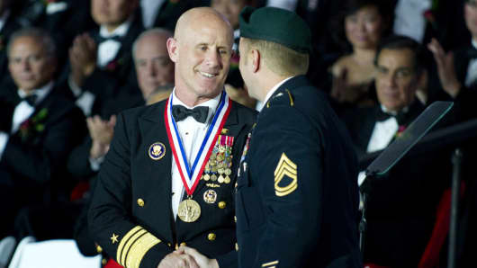 U.S. Navy Vice Admiral Robert S. Harward receives the Ellis Island Medal of Honor Award from a U.S. Army Special Forces Soldier during a ceremony at Ellis Island in New York, U.S. May 12, 2012.