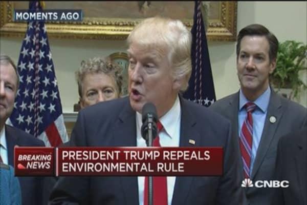 Trump repeals 'wasteful regulation' against coal industry