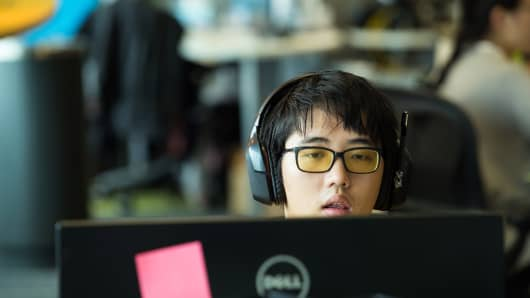 An employee works at the Garena Interactive Holding Ltd. headquarters in Singapore.
