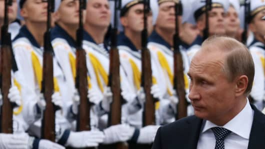 Russian President Vladimir Putin visits the destroyer Vice-Admiral Kulakov at the Naval Base of Black Sea Fleet on September 23, 2014 in Novorossiysk, Russia.