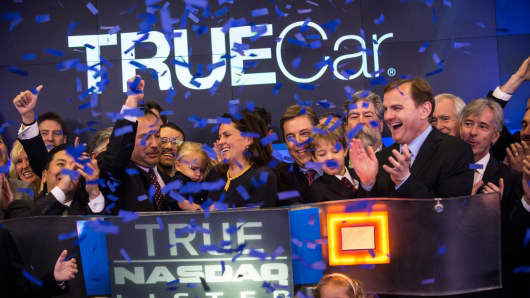 Employees of TrueCar celebrate while ringing the opening bell for the Nasdaq Exchange in Times Square on May 16, 2014 in New York City.