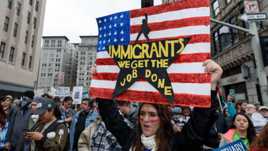 Protesters at a pro-immigration rally where organizers called for a stop to the Immigration and Customs Enforcement (ICE) raids and deportations of illegal immigrants.