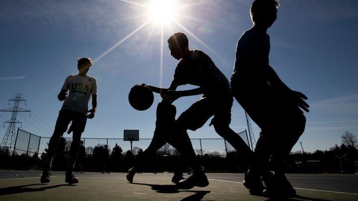 Kids play basketball on a new court at Harris Township Park, Feb. 17, 2017 in Granger, Ind.