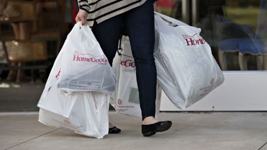 A shopper carries bags outside a HomeGoods store in Peoria, Illinois.