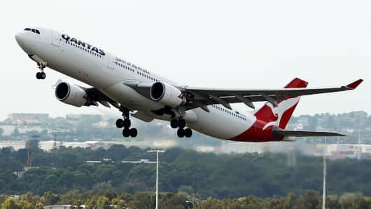 Qantas first-half underlying profit falls 7.5 pct