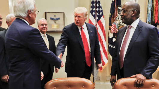 President Donald Trump greets Independence Blue Cross and Health CEO Joseph R. Swedish, left, and Kaiser Permanente CEO Bernard J. Tyson, right, during a meeting with health insurance company executives, Monday, Feb. 27, 2017, in the White House in Washington.