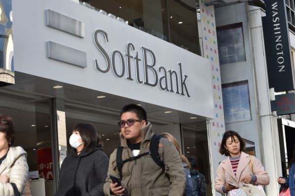 The logo of SoftBank is displayed at an entrance of a shop in Tokyo's shopping district Ginza on February 8, 2017.
