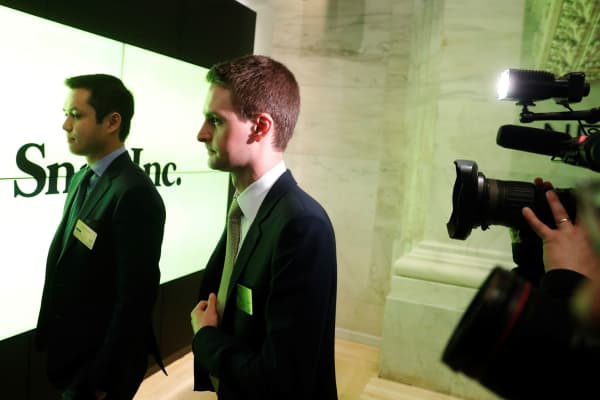 Snap cofounders Evan Spiegel (R) and Bobby Murphy walk to ring the opening bell of the New York Stock Exchange shortly before the company's IPO in New York, March 2, 2017.