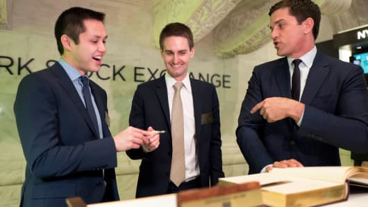 Snapchat co-founders Bobby Murphy, left, and CEO Evan Spiegel sign a guest book at the New York Stock Exchange as Snap celebrates its IPO, Thursday, March 2, 2017.