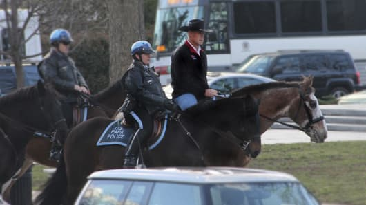 Interior Department shows Interior Secretary Ryan Zinke arriving for his first day of work at the Interior Department in Washington, Thursday, March 2, 2017, aboard Tonto, an 17-year-old Irish sport horse.
