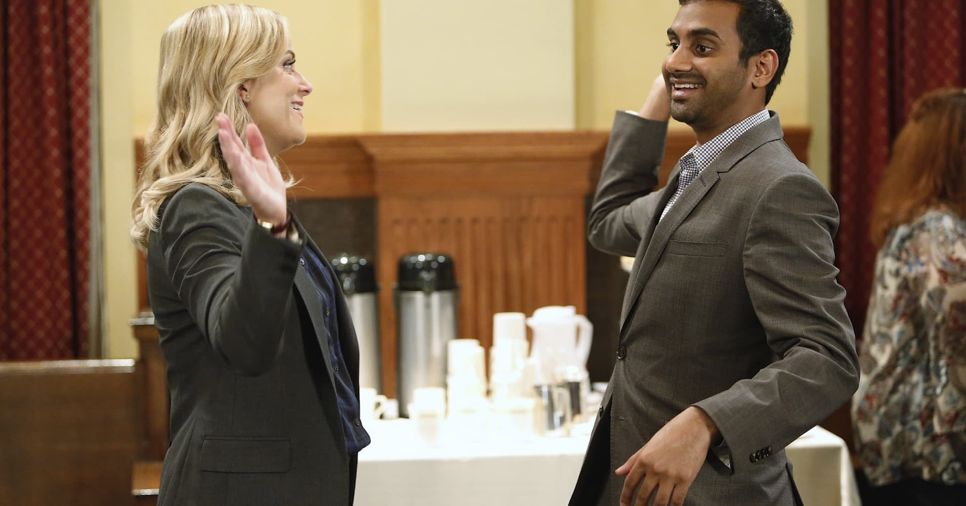 Amy Poehler as Leslie Knope and Aziz Ansari as Tom Haverford on Episode 711 of Parks and Recreation.