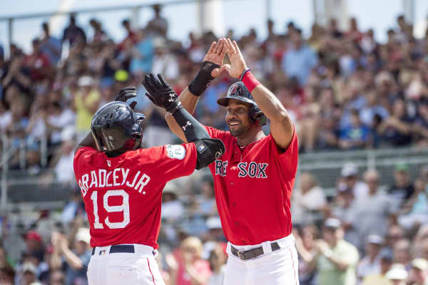 Jackie Bradley Jr. #19 of the Boston Red Sox high fives Chris Young #30