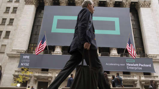 Signs for Hewlett Packard Enterprise Co. cover the facade of the New York Stock Exchange November 2, 2015.