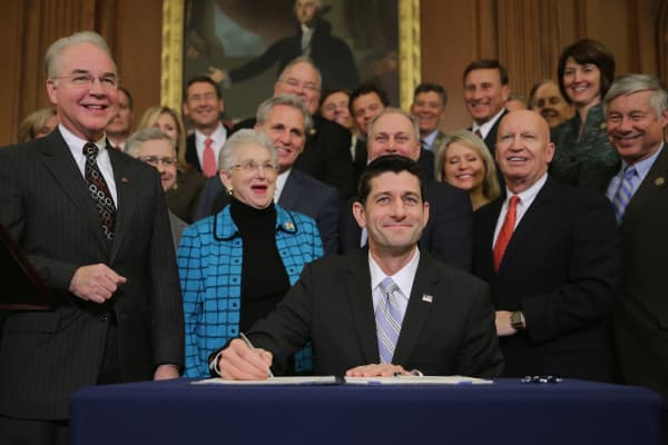 Speaker of the House Paul Ryan (R-WI) signs legislation to repeal the Affordable Care Act, also known as Obamacare, and to cut off federal funding of Planned Parenthood during an enrollment ceremony in the Rayburn Room at the U.S. Capitol January 7, 2016 in Washington, DC.