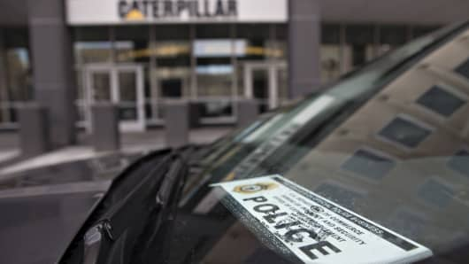 A vehicle displaying a U.S. Department of Commerce Bureau of Industry and Security Office of Export Enforcement Police windshield placard sits parked outside Caterpillar Inc. headquarters in Peoria, Illinois.