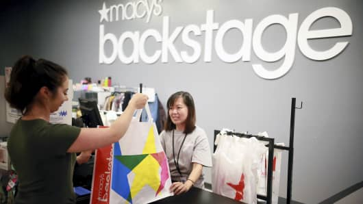 Shoppers pack up their purchases in the new Macy's Backstage store in Melville, New York.