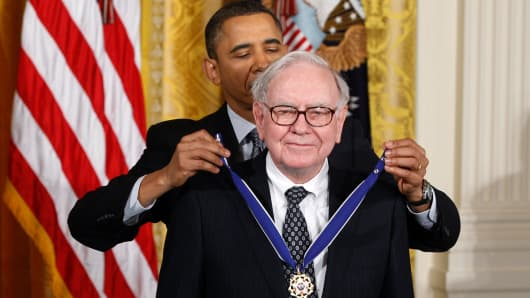 President Barack Obama awards the Medal of Freedom to recipient Warren Buffett during a ceremony to present the awards at the White House in Washington February 15, 2011.