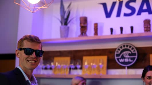 Visa's marketing manager Tom Mansfield shows off the new Visa payment-enabled sunglasses prototyle.