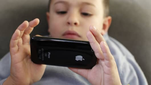 Child plays with phone