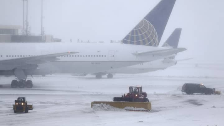 Snowplows work to keep the grounds clear at Newark Liberty International Airport in Newark, N.J.